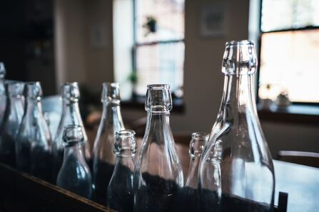 glass bottles for kombucha on bar