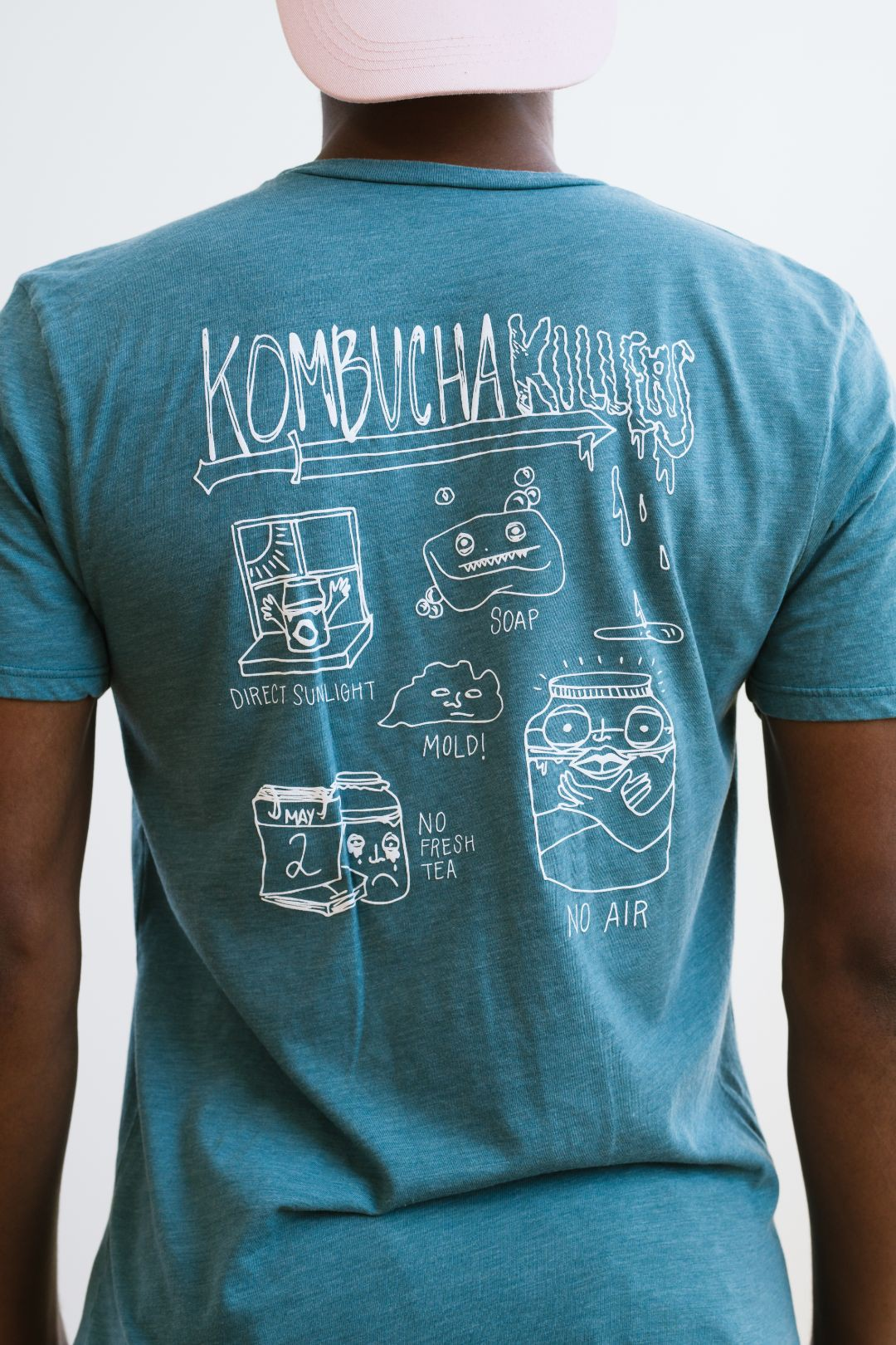 kombucha killers food illustration on back of turquoise green boochcraft shirt